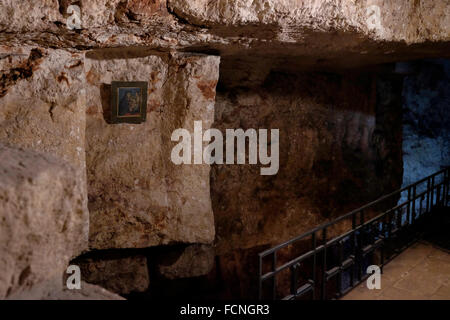 Remnants of the wall date back to the 2nd century inside ancient quarry named Chapel of St. Vartan and the Armenian - Stock Photo