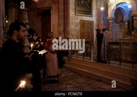 Armenian Orthodox priests taking part in a mass procession at the Chapel of the Division of the Raiment or the Robes - Stock Photo