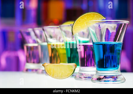 Long perspective row of shots with color drinks - Stock Photo