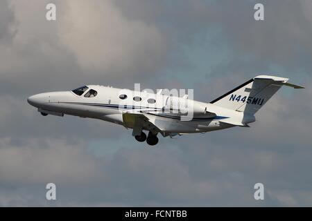 N445MU, a Cessna 510 Citation Mustang, departs from Glasgow Prestwick International Airport. - Stock Photo