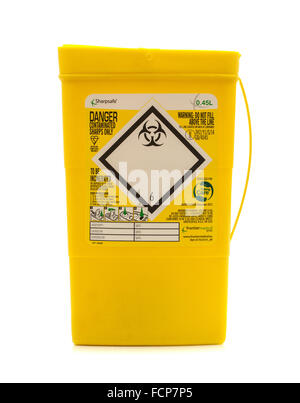 Yellow Sharpsafe biohazard medical contaminated sharps clinical waste container isolated on white - Stock Photo
