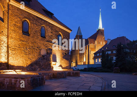 Ostrow Tumski at night in city of Wroclaw, Poland, on the left Church of St. Martin, farther Church of the Holy - Stock Photo