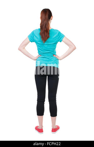 back view of standing young beautiful woman. girl watching. Rear view people collection. backside view of person. - Stock Photo