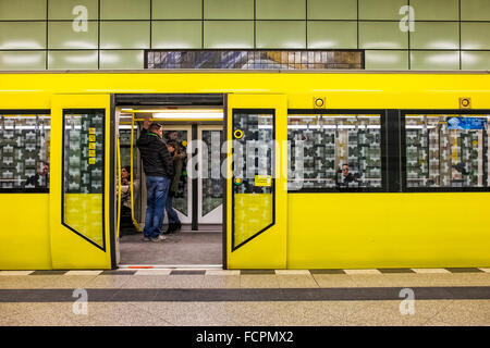Berlin U-bahn - U5 Magdalenenstrasse underground railway station platform with tyellow commuter train with open - Stock Photo