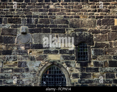 Exterior detail with sundial on S wall of C7th nave of Escomb Saxon church, County Durham, built of stones brought - Stock Photo