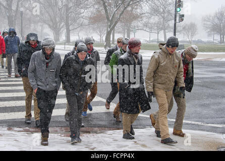 Participants in the annual March for Life walk through the snow near the United States Capitol in Washington, DC - Stock Photo