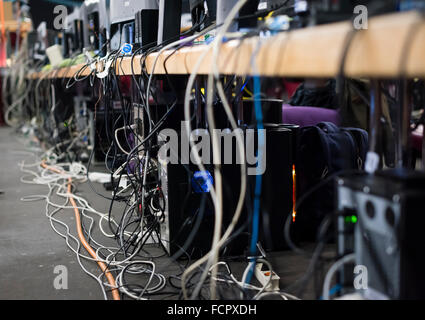 Many computer network cables are connecting PCs at NetGame, Switzerland's largest computer game convention. - Stock Photo
