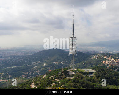 Television antenna tower / TV mast Torre de Collserola on top of Tibidabo Mountain, Barcelona, Spain. - Stock Photo