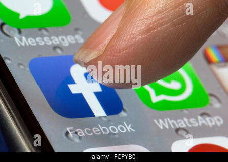 Facebook app icon on an iphone 6 - Stock Photo