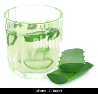 Aloe juice in a glass over white background - Stock Photo