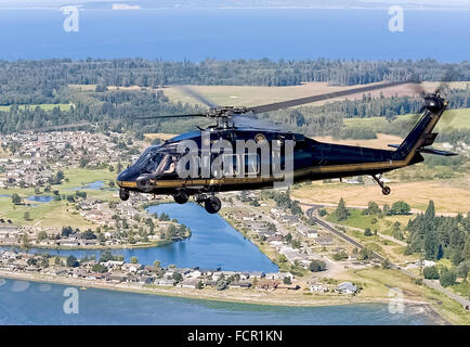 US Customs and Border Protection CBP Office of Air and Marine unit operating a Sikorsky UH-60 Blackhawk helicopter - Stock Photo