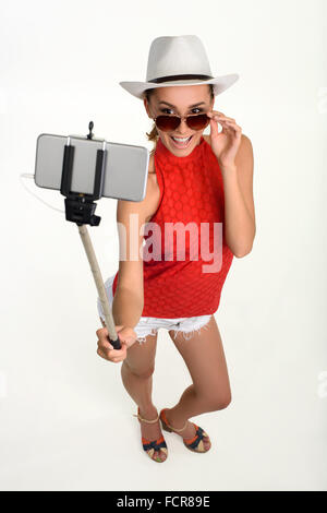 Pretty young traveller making selfie. - Stock Photo