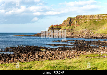 Giants Causeway, unique geological formation of rocks and cliffs in Antrim County, Northern Ireland, in sunset light - Stock Photo