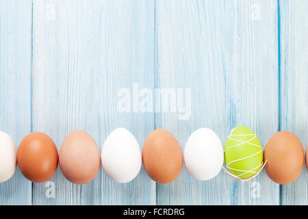 Easter eggs on wooden table. Top view with copy space - Stock Photo