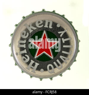 Heineken Beer Bottle Top on a White Background - Stock Photo