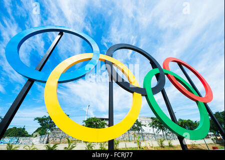 RIO DE JANEIRO - OCTOBER 31, 2015: Olympic rings stand against blue sky in Parque Madureira Park, in the Zona Norte - Stock Photo