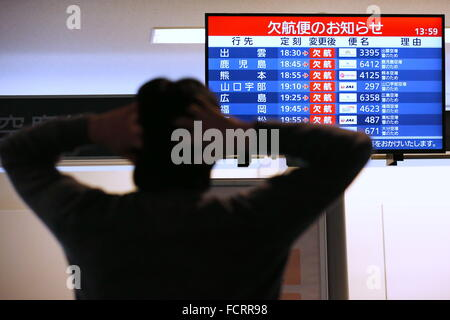 Cancelled flights are listed on a display at Haneda Airport on January 24, 2016, in Tokyo, Japan. Some air services - Stock Photo