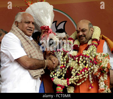 New Delhi, India. 24th Jan, 2016. A supporter congratulates Amit Shah (R) during the felicitation ceremony after - Stock Photo