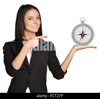 Office girl standing on white background and holding compass - Stock Photo