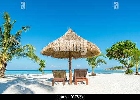 Summer, Travel, Vacation and Holiday concept - Beach Chairs and Umbrella on island in Phuket, Thailand - Stock Photo
