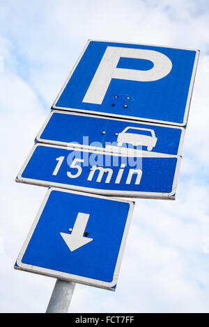 Parking road signs over cloudy sky background in Finland - Stock Photo
