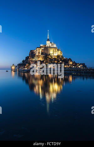 Mont Saint-Michel (Saint Michael's Mount), (Normandy, north-western France), on 2015/02/18: spring tide of the evening. - Stock Photo