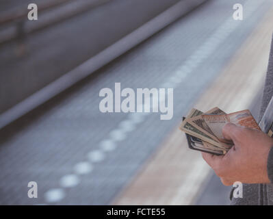 Multiple currencies in one wallet ready for some international travel. - Stock Photo