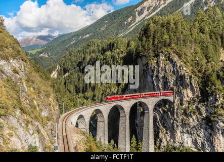Glacier Express at the Landwasser Viaduct at Swiss Alps, Switzerland   Glacier Express auf Landwasser Viadukt, Schweiz - Stock Photo
