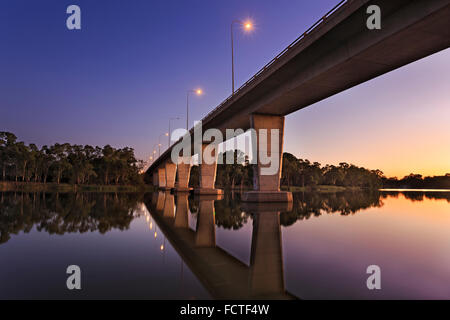 Modern tall bridge over Murray river near Mildura as a boundary between NSW and VIC in Australia at sunrise - Stock Photo
