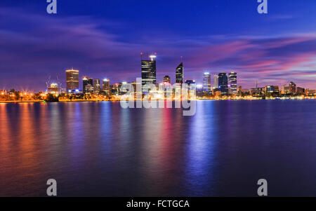 Western Australia capital city Perth CBD at sunrise reflecting in still waters of swan river - Stock Photo