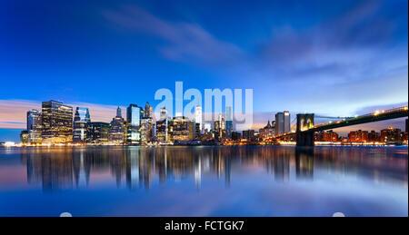 New York City - beautiful sunrise over manhattan with manhattan and brooklyn bridge USA - Stock Photo