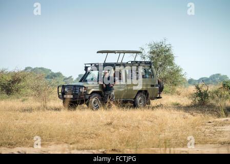tourist in Murchison Falls National Park, Uganda, Africa - Stock Photo
