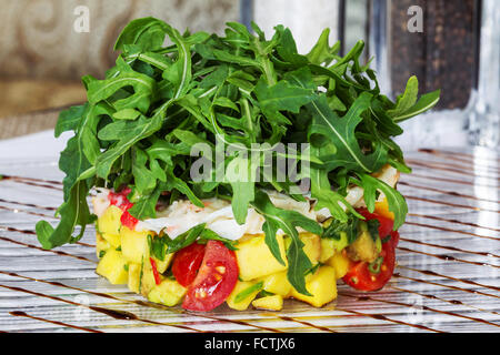 Fresh tomato and avocado with aromatic herbs - Stock Photo