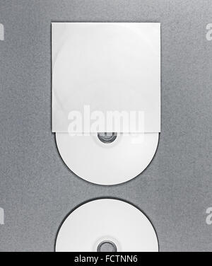 Photo of blank CD on gray background. Template for design presentations and portfolios. Mockup for branding identity. - Stock Photo