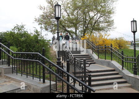 long stone staircases with lantern and lattice decoration for city park, May, 2015, Minsk - Stock Photo