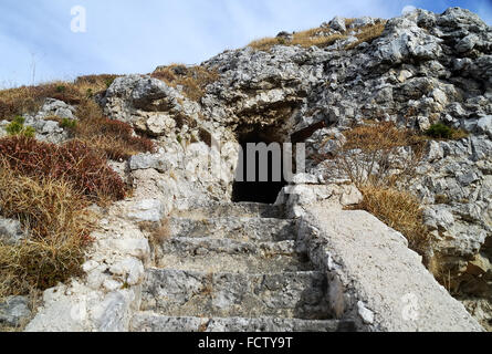 WWI. Asiago Plateau. Mount Forno. Austro-Hungarian machine gun nest. The stairway to the machine gun in the cave. - Stock Photo