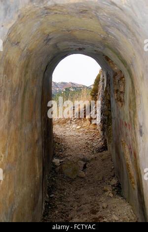 WWI. Asiago Plateau. Mount Forno. Austro-Hungarian machine gun nest in cave. Access tunnel. - Stock Photo