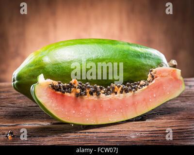 Papaya fruit on wooden background. - Stock Photo
