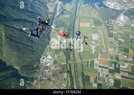This 4-way formation skydiving team is training for the National Championship. The videoman above is filming everything - Stock Photo