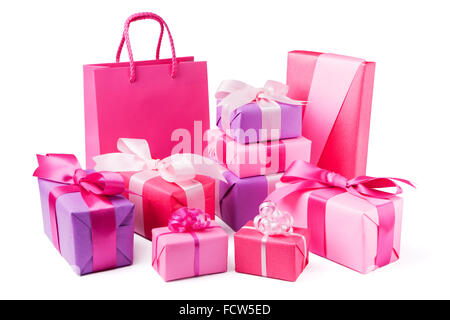 A collection of pink and purple Valentine's gifts with satin ribbons. - Stock Photo