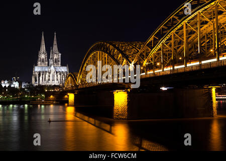 Hohenzollern Bridge and Cologne Cathedral at Night - Stock Photo