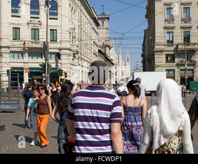 pedestrians in Via Dante and Piazza Cordusio, Milan, Italy - Stock Photo