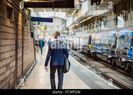 Businessman at the station - Stock Photo