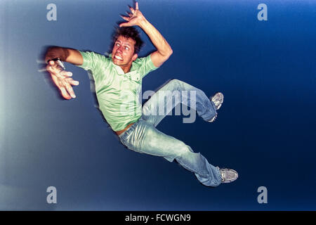 LOS ANGELES, CA – JUNE 29: Man jumping in air in Los Angeles, California on April 30, 2004. - Stock Photo