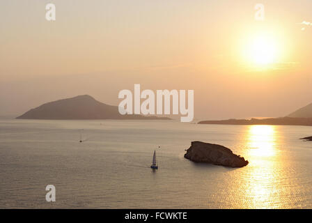 The magnificent golden sunset on the Aegean Sea at Cape Sounion. Greece. - Stock Photo