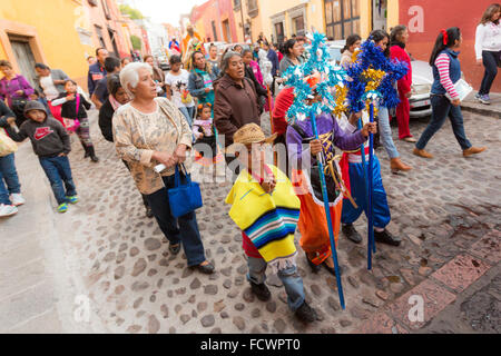 A procession of children lead the Three Kings through the cobble streets during El Dia de Reyes January 6, 2016 - Stock Photo
