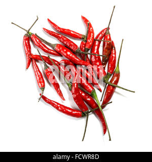 A group of red birds eye chillies on a white background - Stock Photo