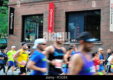 Runners in the 2015 Chicago Marathon blur as they near the one mile mark on Grand Avenue of the 26.2 mile course. - Stock Photo