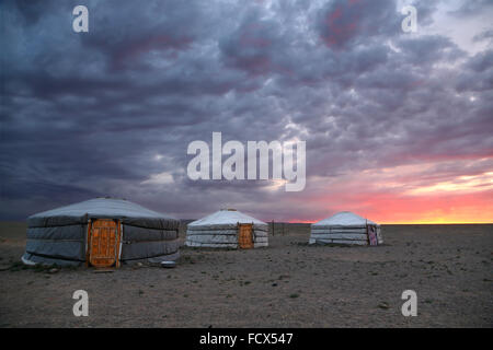Sunrise and traditional yurts in Gobi desert -  Mongolia - Stock Photo