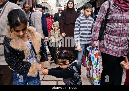 Muslim Woman in the crowd at Damascus gate in Jerusalem ,  Middle East - Stock Photo